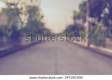 vintage tone image of blur walkway with sunny day in park for background usage . - stock photo