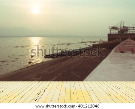 vintage tone image of boat at Gwanpayao (large freshwater lake) Payao,Thailand evening time with sunset.(selective focus onboat) - stock photo