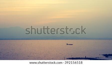vintage tone image of Gwanpayao (large freshwater lake) Payao,Thailand evening time with sunset. - stock photo