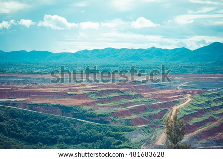 vintage tone image of lignite mine pit on day time with line of mountain background(Mae Mo mine)