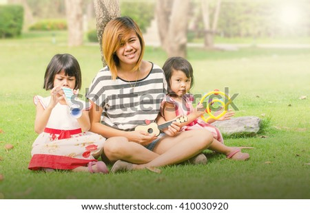Vintage Tone Mom and Child is learn in the park