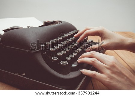 Vintage tone of Hands writing on old typewriter - stock photo