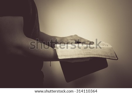 Vintage tone of man reading the Holy Bible. - stock photo