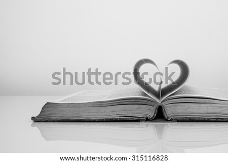 Vintage tone of Pages of a book forming the shape of the heart. Passion for reading. - stock photo