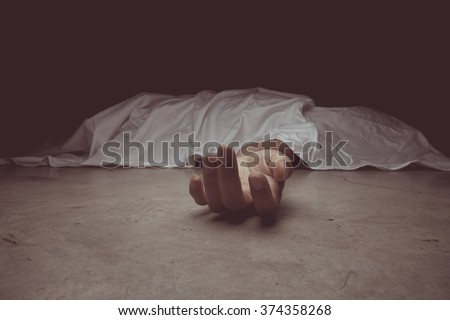 vintage tone of The dead woman's body. Focus on hand - stock photo