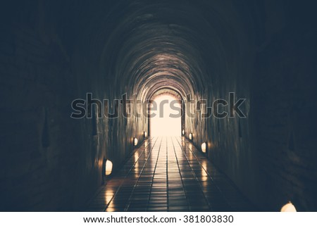 vintage tone of tunnel and light at the end.