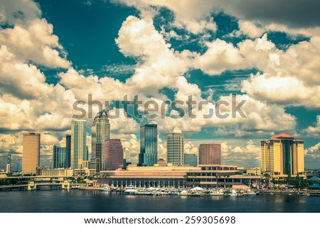 Vintage tone style image of Tampa Florida skyline under beautiful clouds - stock photo