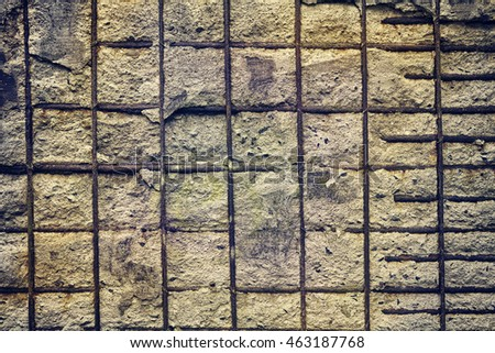 Vintage toned background made of reinforced concrete wall.