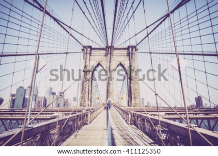 Vintage toned blurred photo of the Brooklyn Bridge, NYC.