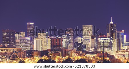 Vintage toned Denver downtown skyline at night, Colorado, USA.