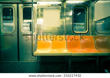 Vintage toned image of empty New York City subway car - stock photo