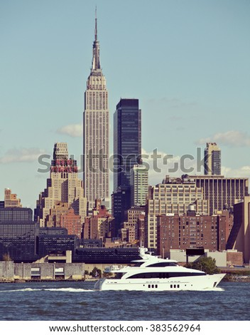 Vintage toned, Instagram effect filter from  New York Empire State Building. Boat cruise - stock photo
