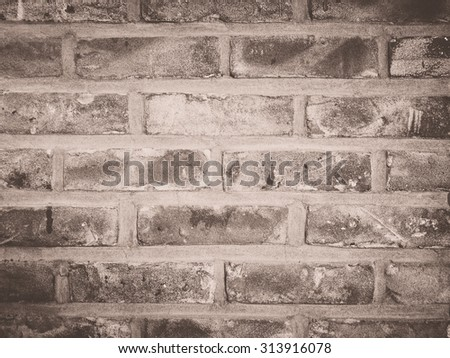 Vintage toned interior brick wall for texture or background - stock photo
