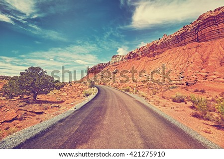 Vintage toned picture of a desert road, travel concept, USA.