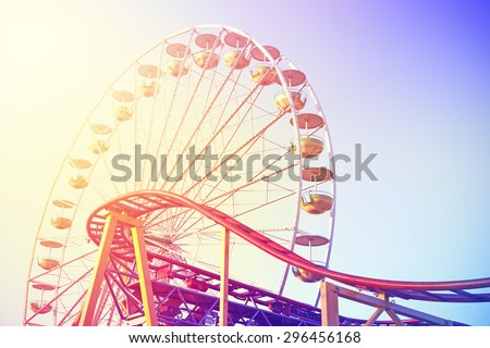 Vintage toned picture of an amusement park. - stock photo