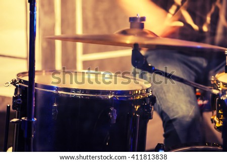 Vintage toned rock music blurred photo background, drummer on a stage - stock photo
