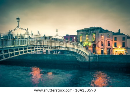 Vintage toned view Ha'Penny Bridge Dublin Ireland - stock photo