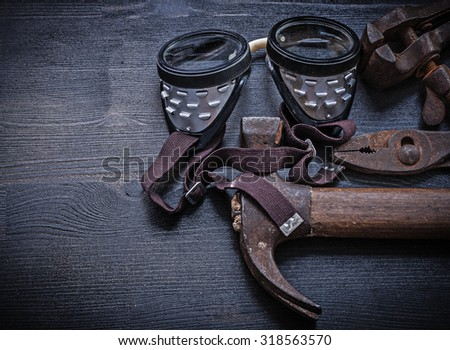 vintage tools goggles hammer pliers clamp. - stock photo