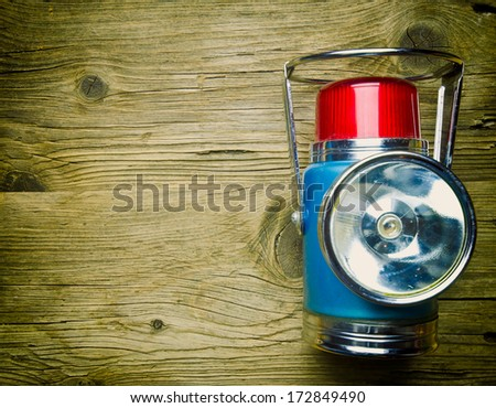 Vintage torch on old wood surface - stock photo