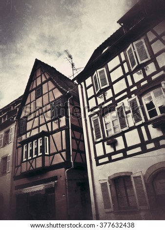 Vintage townscape representing half-timbered french traditional houses facades in Alsace