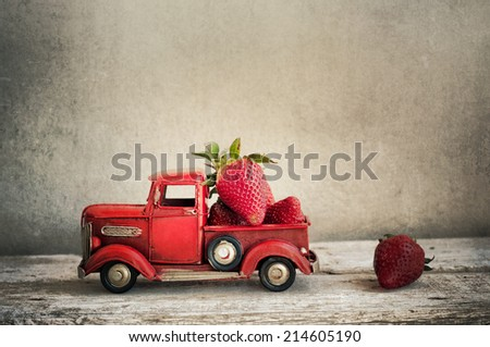 Vintage toy truck with strawberries - stock photo