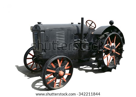 vintage tractor on white background with shadow - stock photo