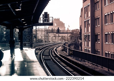 Vintage train station with railway lines in Berlin. Retro filtered. Monochrome cream tone. Black and white photography. - stock photo