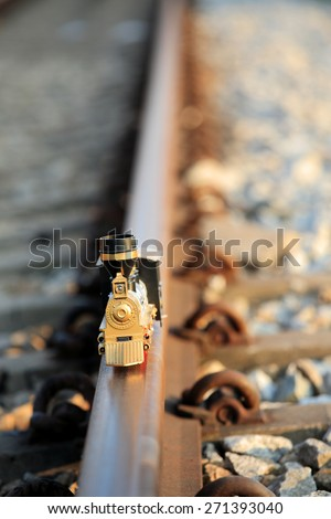Vintage train toy model on rail.Shallow depth of field composition. - stock photo