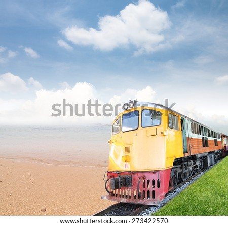 Vintage train with sea and blue sky - stock photo