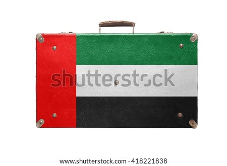 Vintage travel bag with flag of United Arab Emirates isolated on white background. - stock photo