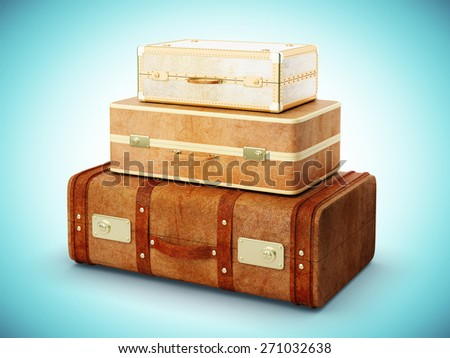 vintage travel bags on a blue background - stock photo