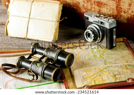 vintage  travel memories concept. Old camera, binoculars, letters and map-holder with map