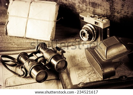 vintage  travel memories concept. Old camera, binoculars, letters and map holder with map with vignette