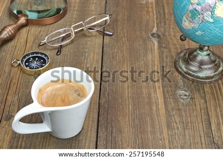 Vintage Travel or Adventure or Expedition or Exploration  Items On Wooden Grunge Table. - stock photo