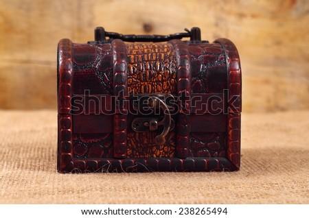 vintage treasure chest closeup on table - stock photo