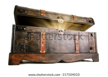 Vintage treasure chest opens to reveal a luminous but hidden secret - stock photo