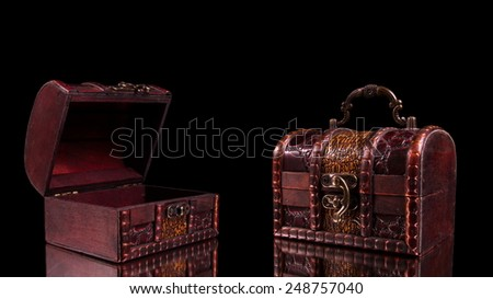 vintage treasure chests closeup on table - stock photo