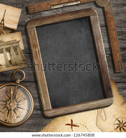 Vintage treasure map, blackboard with copyspace, old compass still life. Adventure or discovery concept. - stock photo