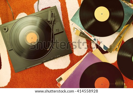 vintage turntable on orange carpet - stock photo