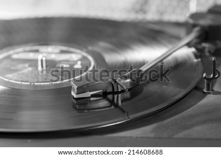 Vintage turntable with a record playing
