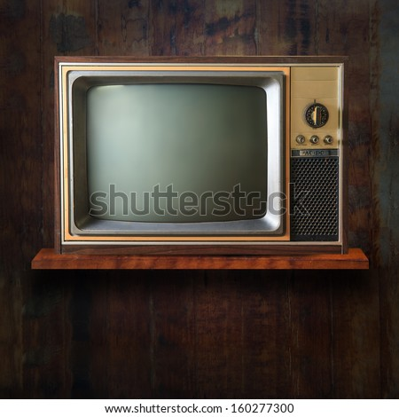 Vintage tv on wood shelf