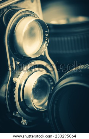 Vintage twin reflex camera and lenses - stock photo