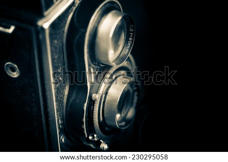 Vintage twin reflex camera isolated on a black background - stock photo
