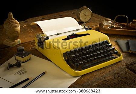 Vintage typewriter above an old wooden desk - overwrite your text on the sheet