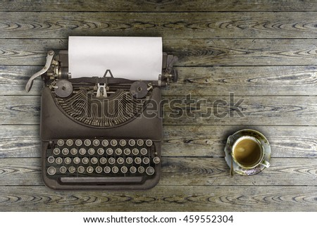 Vintage typewriter and coffee on wood background,top view.  - stock photo