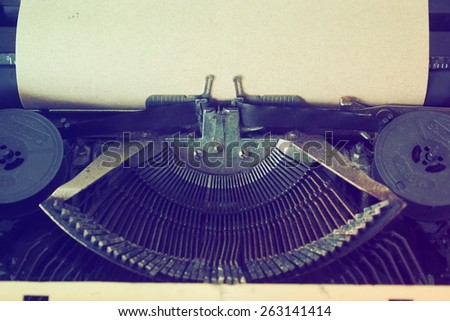 Vintage typewriter and paper in vintage color tone - stock photo