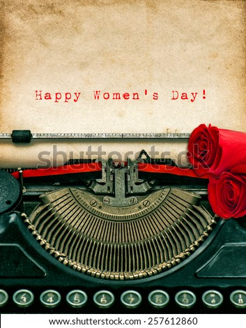Vintage typewriter and red rose flowers. Aged textured grungy paper. Sample text Happy Women's Day! - stock photo