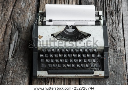 vintage typewriter and telephone , notebook on the wood desk - stock photo