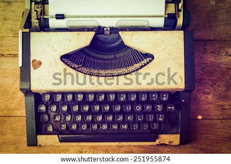 vintage typewriter and telephone , notebook on the wood desk in vintage color tone - stock photo