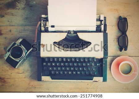 vintage typewriter and vintage camera and coffee on the wood background vintage color tone  - stock photo